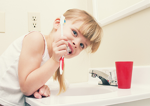 brushing tips kids - Ease up on your gums — don't brush your teeth too hard!